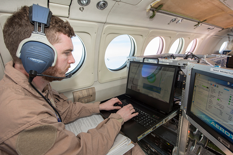 Radar operator monitors incoming wind data during science flight