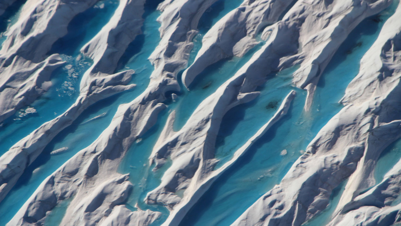 Crevasses in southern Greenland are visible from a 2017 Operation IceBridge airborne survey of the region.
