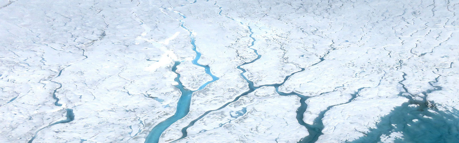 slide 4 - Photo of meltwater rivers on Greenland's ice sheet