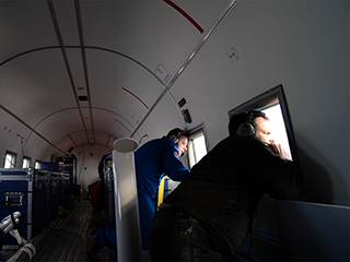 Josh Willis drops a probe during OMG's fall 2018 airborne campaign