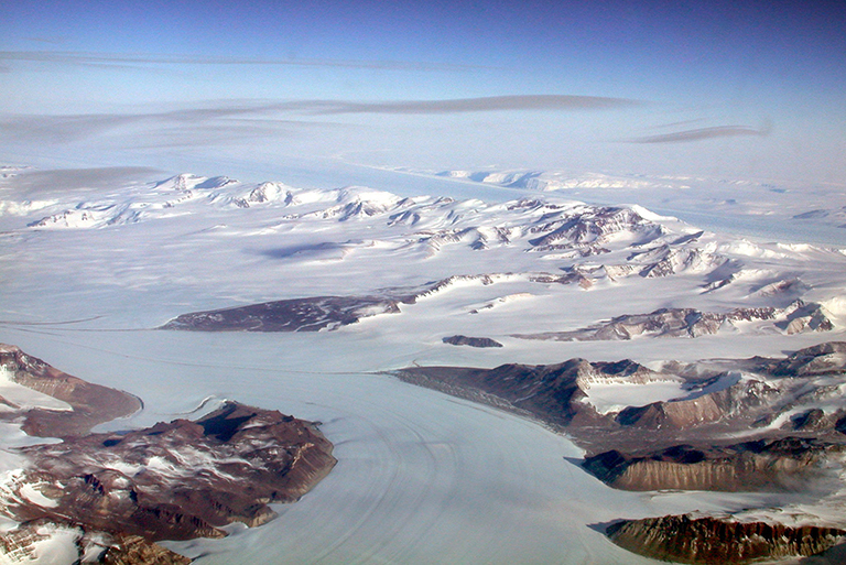 Meltwater from Antarctica glaciers like Darwin (foreground) and Byrd affects sea levels in the U.S. Credit: NSIDC/Ted Scambos