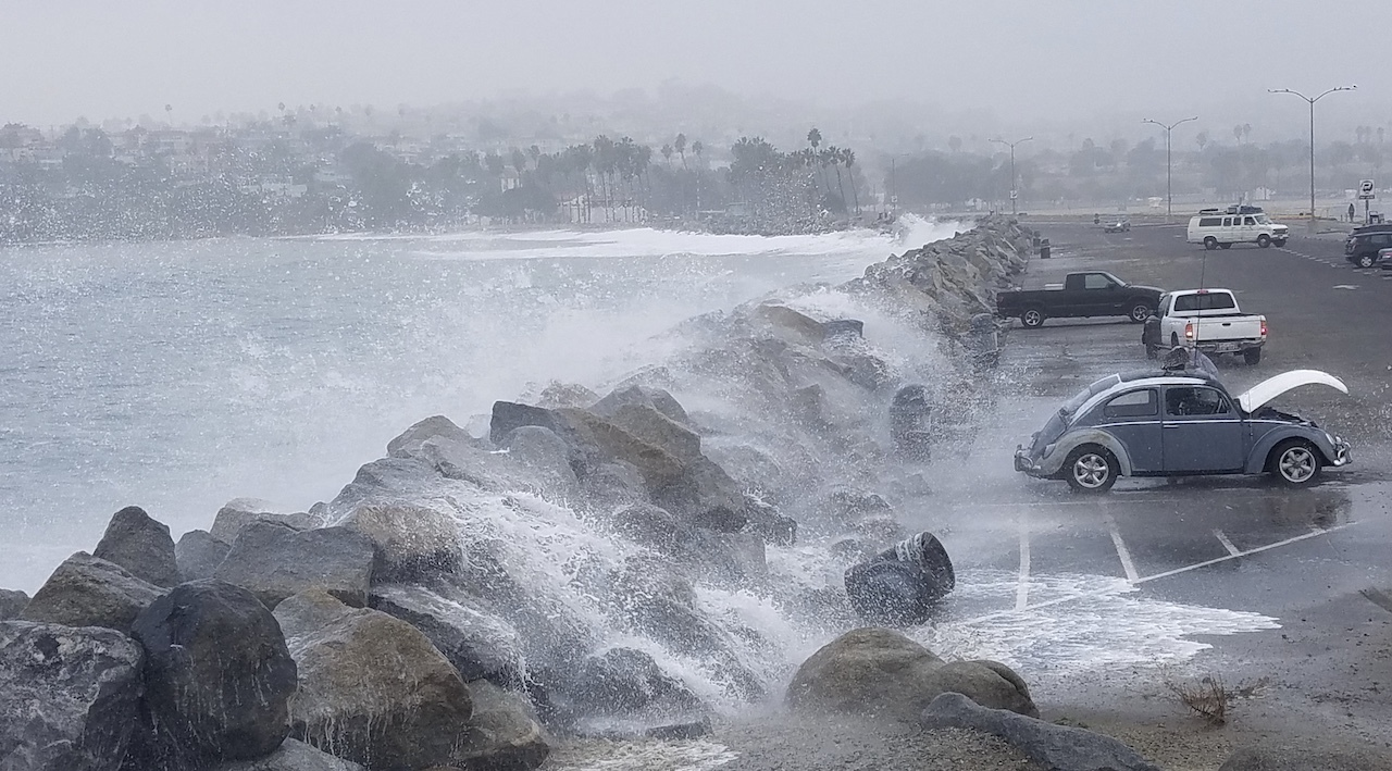 Waves wash into parking lot in Cabrillo Beach, California.