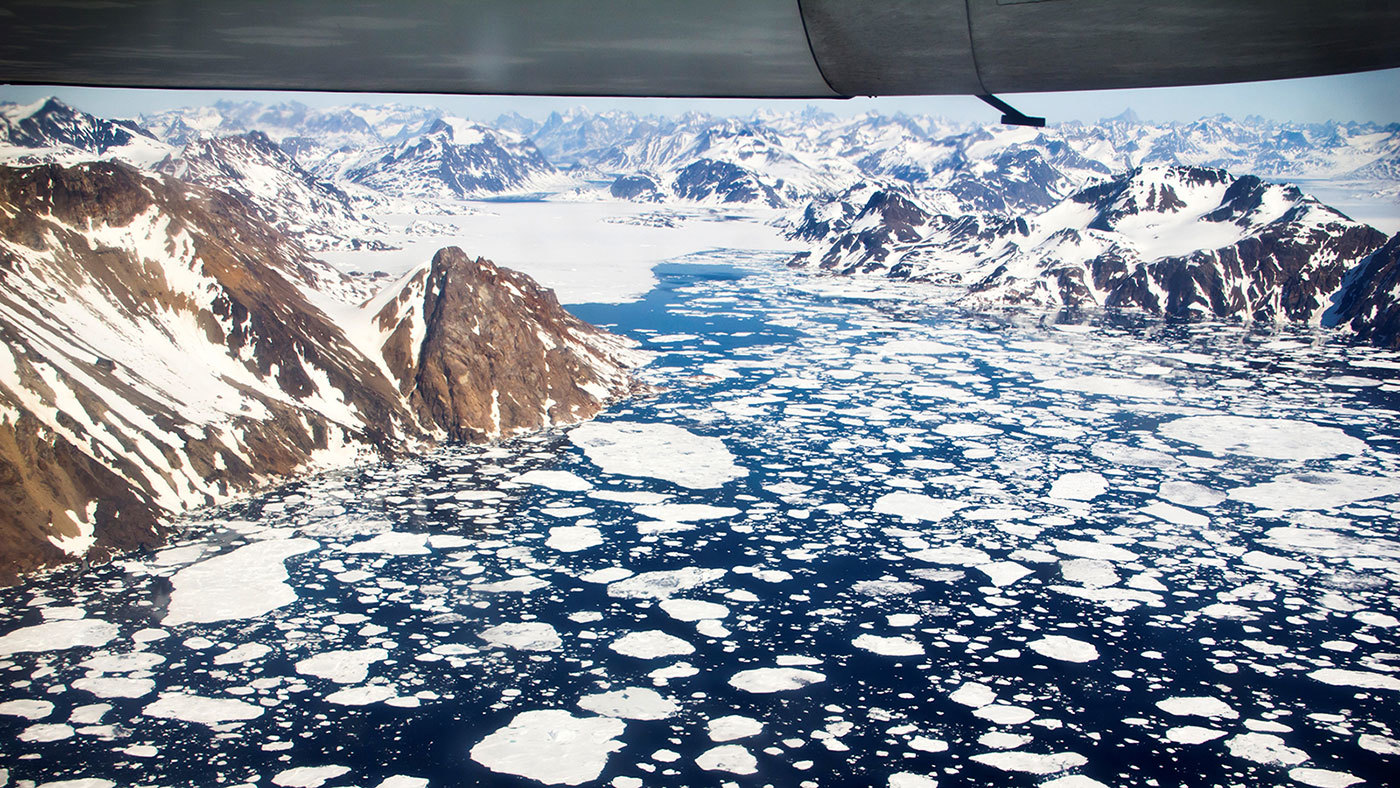 An aerial view of the icebergs near Kulusuk Island, off the southeastern coastline of Greenland, a region that is exhibiting an accelerated rate of ice loss. Credit: NASA Goddard Space Flight Center