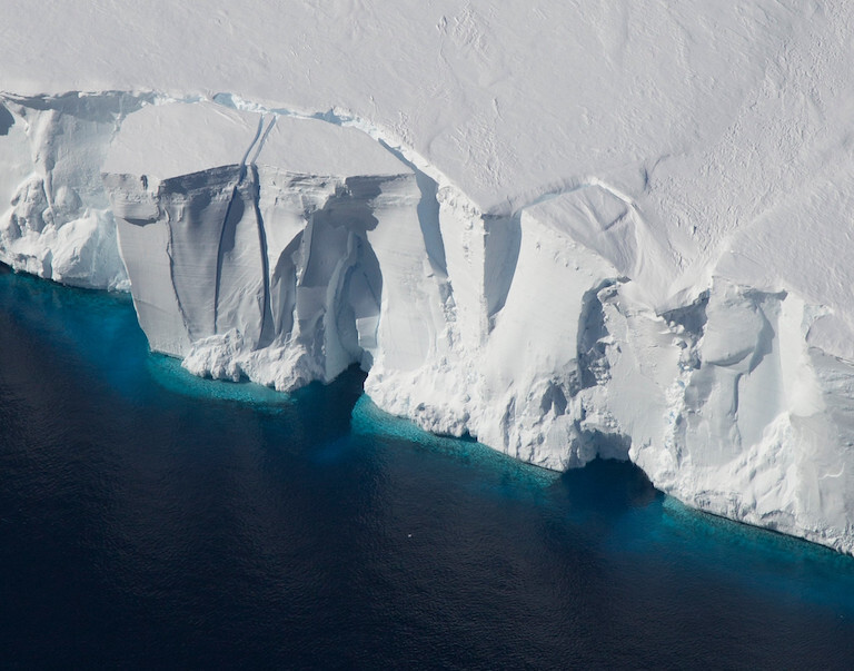 Ice shelves in Antarctica, such as the Getz Ice Shelf seen here, are sensitive to warming ocean temperatures. Ocean and atmospheric conditions are some of the drivers of ice sheet loss that scientists considered in a new study estimating additional global sea level rise by 2100. Credit: NASA/Jeremy Harbeck
