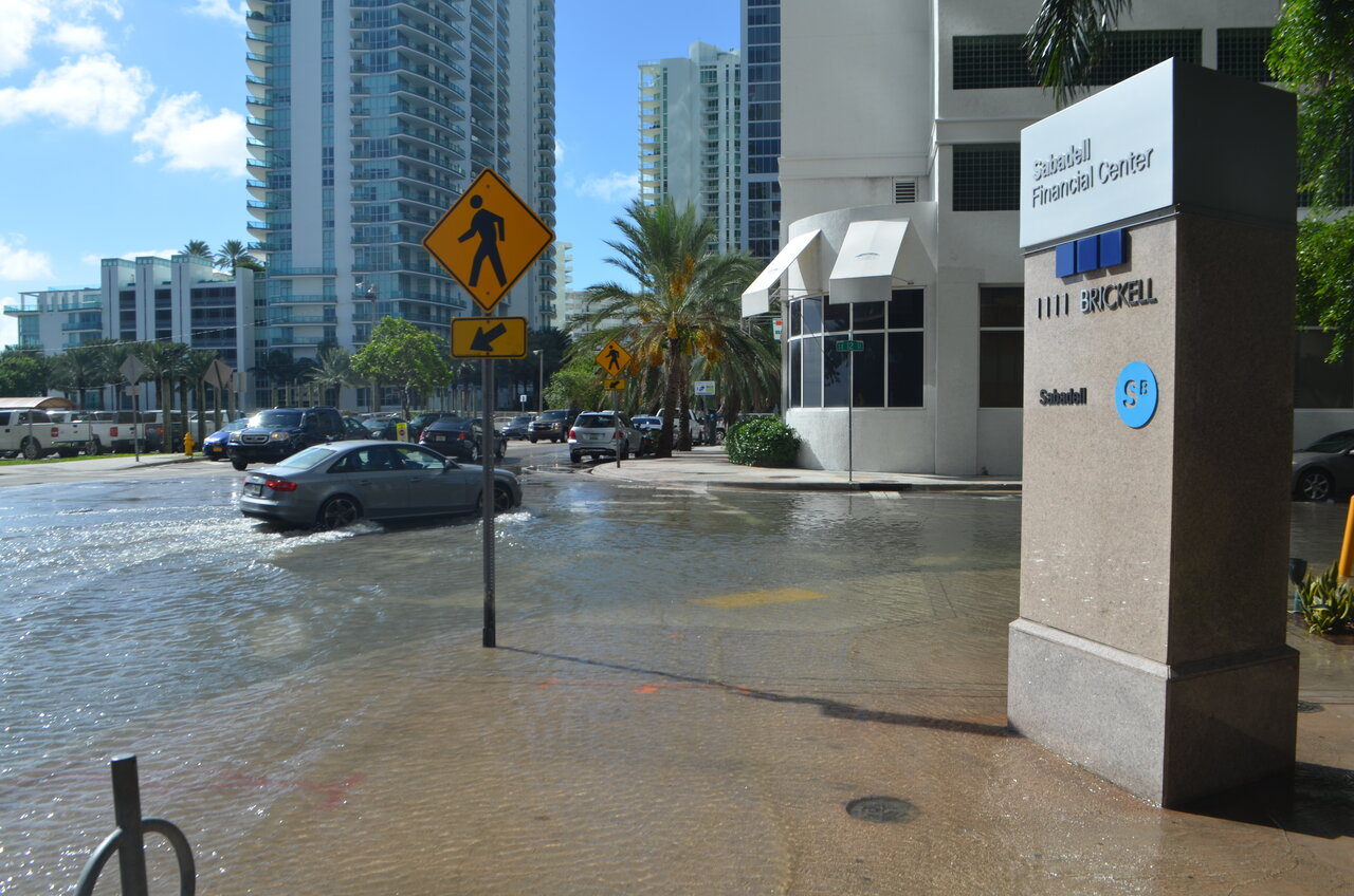 Sunny day high tide nuisance flooding in downtown Miami, Florida in October 2016.