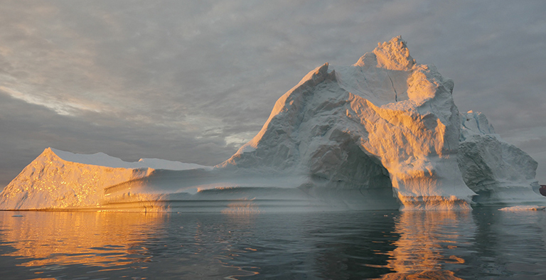 An iceberg floats in Disko Bay, near Ilulissat, Greenland, on July 24, 2015. The massive Greenland ice sheet is shedding about 300 gigatons of ice a year into the ocean, making it the single largest source of sea level rise from melting ice. Credit: NASA/Saskia Madlener