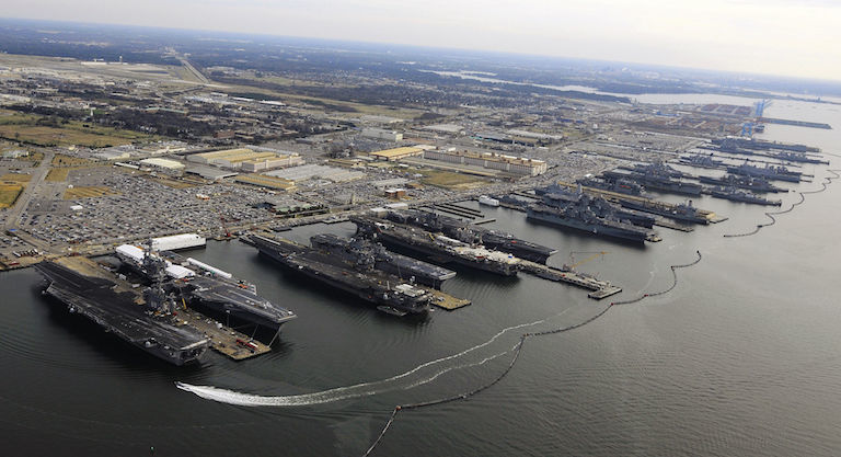 Norfolk Naval Station at Hampton Roads, Va., is among the coastal facilities facing the prospect of adapting to rising sea levels. Image credit: Mass Communication Specialist 2nd Class Ernest R. Scott