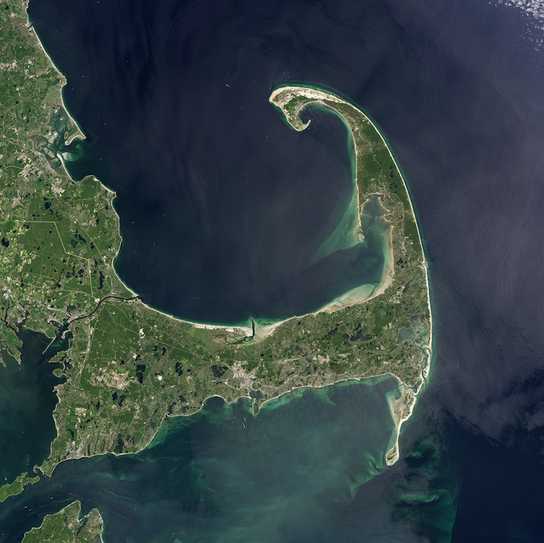 Cape Cod as seen by the Landsat 5 satellite in 2013. A new pair of studies says neglected meteorological effects could account for a more significant percentage of sea-level change along the northeastern U.S. coast than previously thought. Image credit: NASA Earth Observatory.