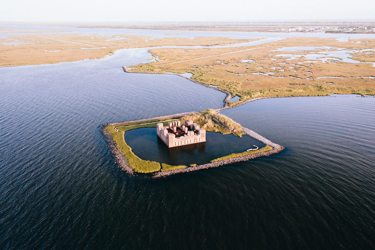 The ruins of a Civil War-era structure, Fort Beauregard, lie partially submerged east of New Orleans. Researchers say many large coastal cities around the world sink faster than sea levels rise.