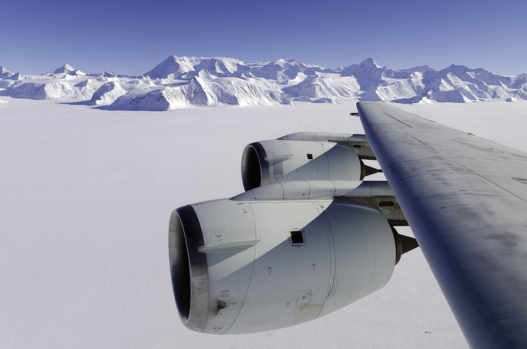 NASA's DC-8 flying laboratory flies past Antarctica's Mt. Vinson during ice-monitoring campaign called Operation IceBridge. Laser altimetry measurements from IceBridge showed rapid retreat of Antarctic glaciers.