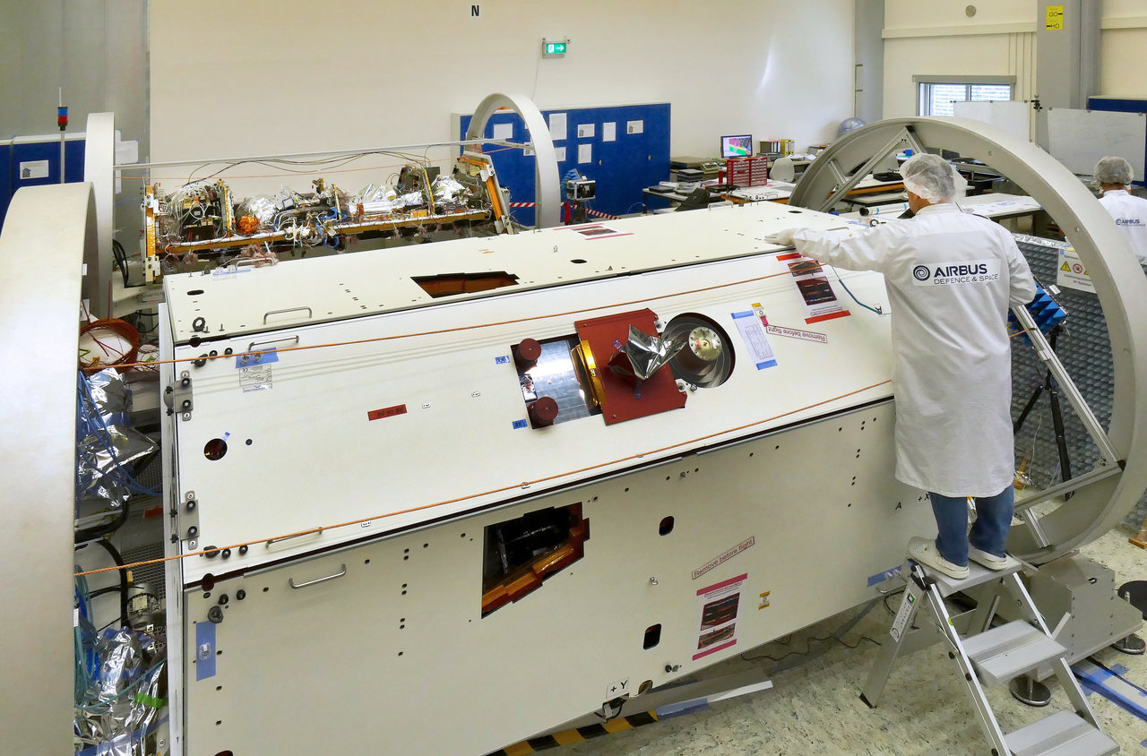 A technician inspects one of the two satellites for NASA's Gravity Recovery and Climate Experiment Follow-On (GRACE-FO) mission at the Airbus Defence and Space manufacturing facility in Friedrichshafen, Germany. The other GRACE-FO satellite is visible in the background. Credit: Airbus DS GmbH-A.Ruttloff 2016