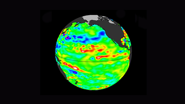 Data collected Feb. 28 – March 12, 2017, by the U.S./European Jason-3 satellite show near-normal ocean surface heights in green, warmer areas in red and colder areas in blue. Ocean surface height is related in part to its temperature, and thus is an indicator of how much heat is stored in the upper ocean. Image credit: NASA/JPL-Caltech.