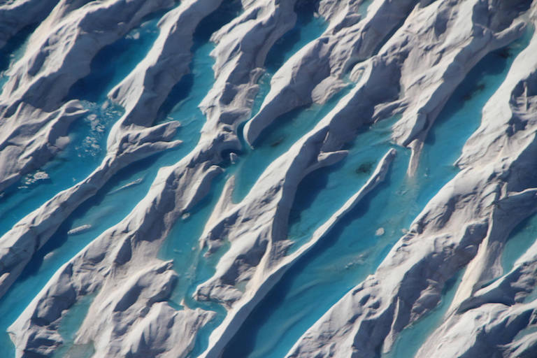 Meltwater in crevasses in southern Greenland, as seen during Operation IceBridge's last flight of the 2017 Arctic campaign, on May 11, 2017. Image credit: NASA/John Sonntag