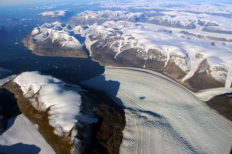 Rink Glacier in western Greenland, with a meltwater lake visible center. Credit: NASA/OIB